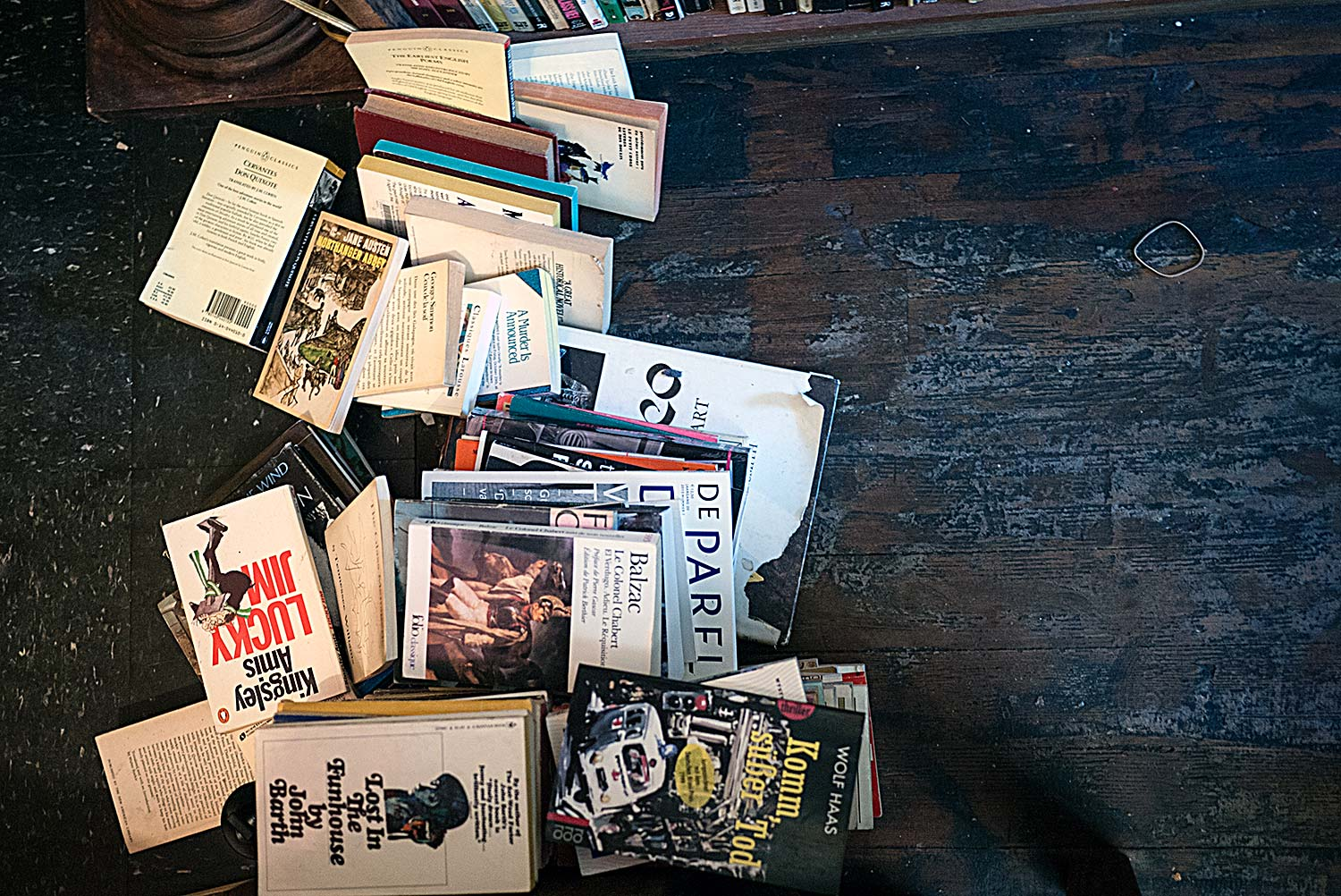 Books in a fallen stack upon the floor
