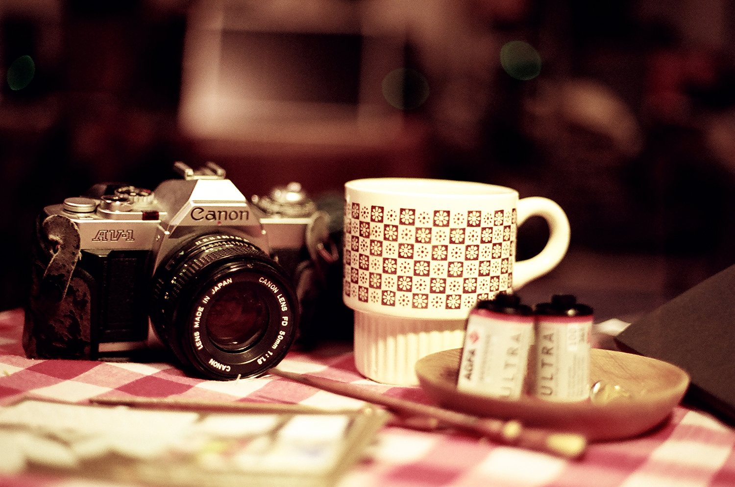 coffee and camera and film at home