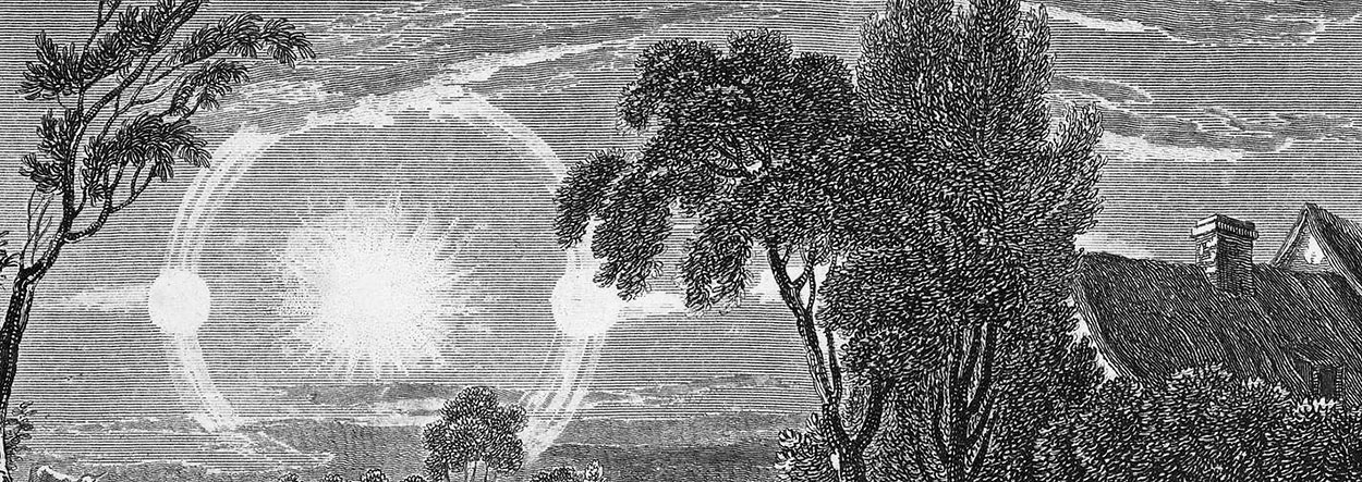 Engraving of sun dogs and trees