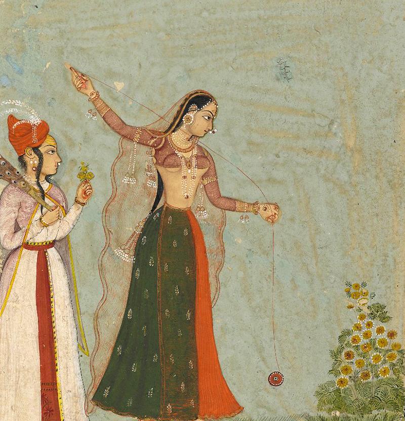 An Indian woman toys with a yo-yo.