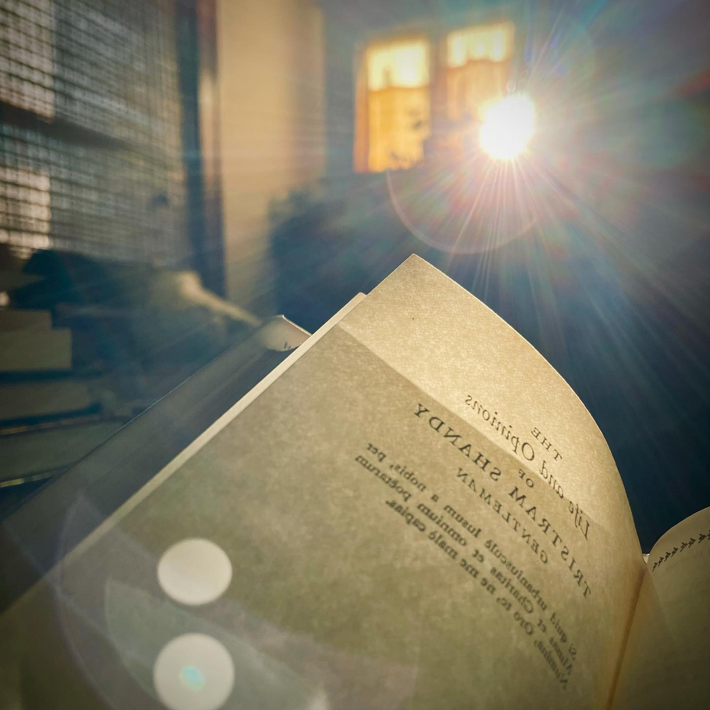 a picture of a book and some dramatic sunlight