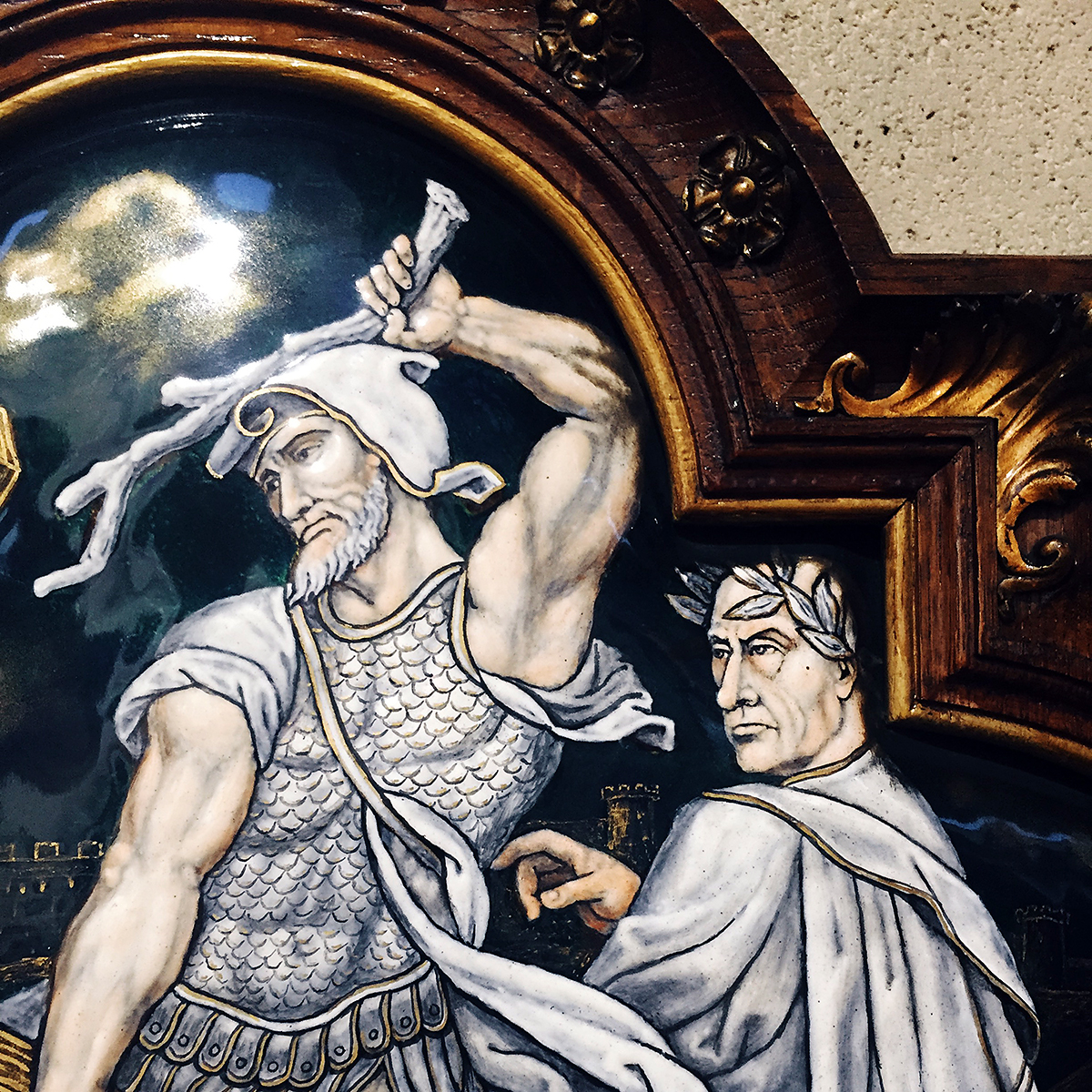 The image of a man raises a club to do some violence on a painted tile